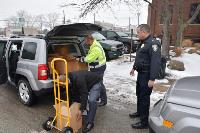 Left to Right-John Hall and Cory Skoczen of the Ohio Turnpike unload MARCS radios as Chief Jeffrey Willis of Ravenna P.D. stands by to receive them